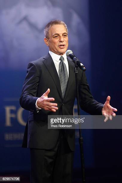 Actor Tony Danza performs onstage during the USO 75th Anniversary Armed Forces Gala Gold Medal Dinner at Marriott Marquis Times Square on December 13...