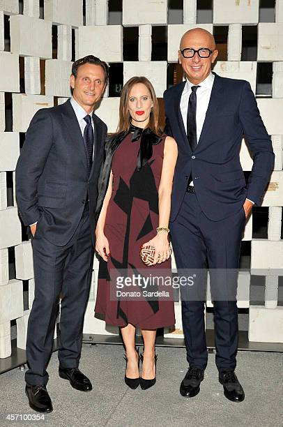 Actor Tony Goldwyn filmmaker Liz Goldwyn wearing FallWinter 2014/2015 Aubergine Nero Washed Polyester Dress Knot and Nero Suede Pump and Bottega...