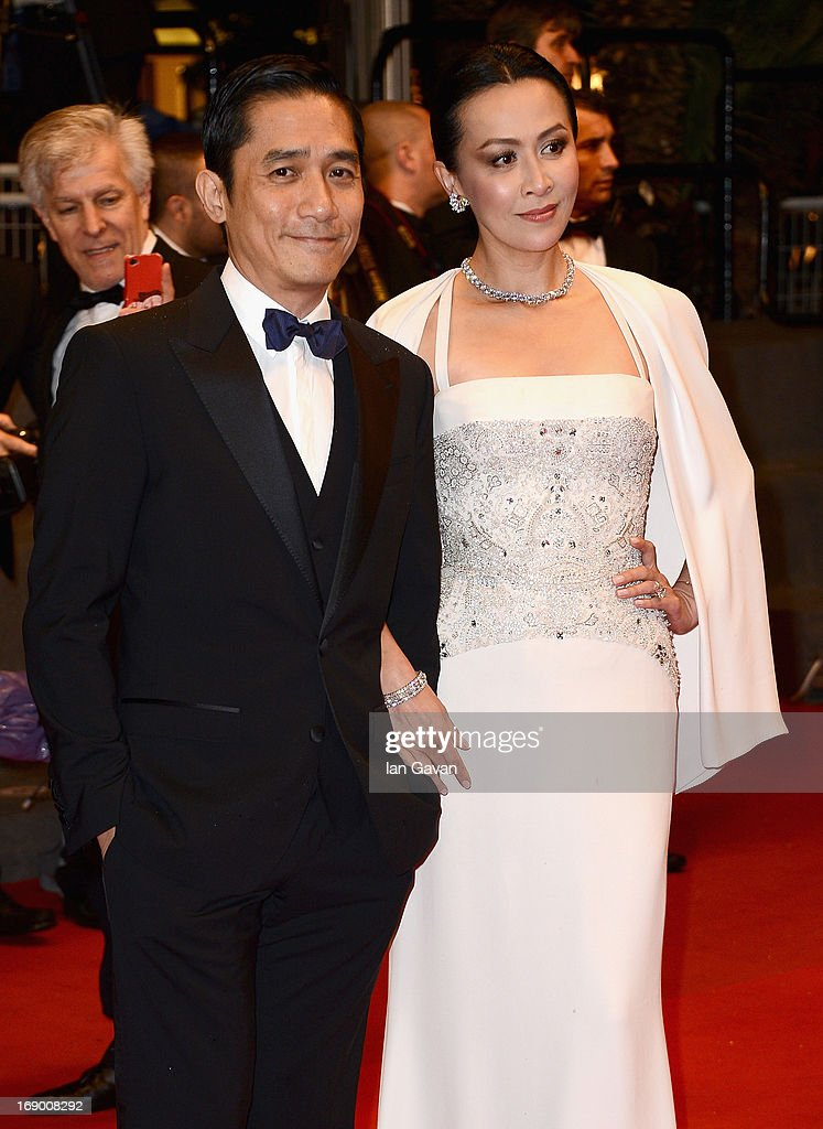 Actor Tony Leung and actress <a gi-track='captionPersonalityLinkClicked' href=/galleries/search?phrase=Carina+Lau&family=editorial&specificpeople=663580 ng-click='$event.stopPropagation()'>Carina Lau</a> attend the 'Bends' Premiere during The 66th Annual Cannes Film Festival at the Palais des festivals on May 18, 2013 in Cannes, France.