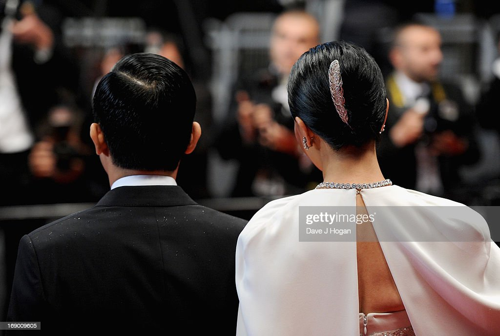 Actor Tony Leung and actress Carina Lau attend the 'Bends' Premiere during The 66th Annual Cannes Film Festival at the Palais des festivals on May 18, 2013 in Cannes, France.