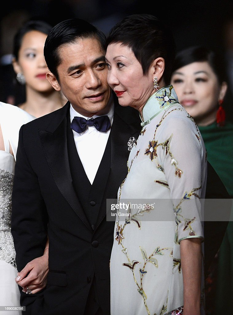 Actor Tony Leung and producer <a gi-track='captionPersonalityLinkClicked' href=/galleries/search?phrase=Nansun+Shi&family=editorial&specificpeople=2229175 ng-click='$event.stopPropagation()'>Nansun Shi</a> attend the 'Bends' Premiere during The 66th Annual Cannes Film Festival at the Palais des festivals on May 18, 2013 in Cannes, France.