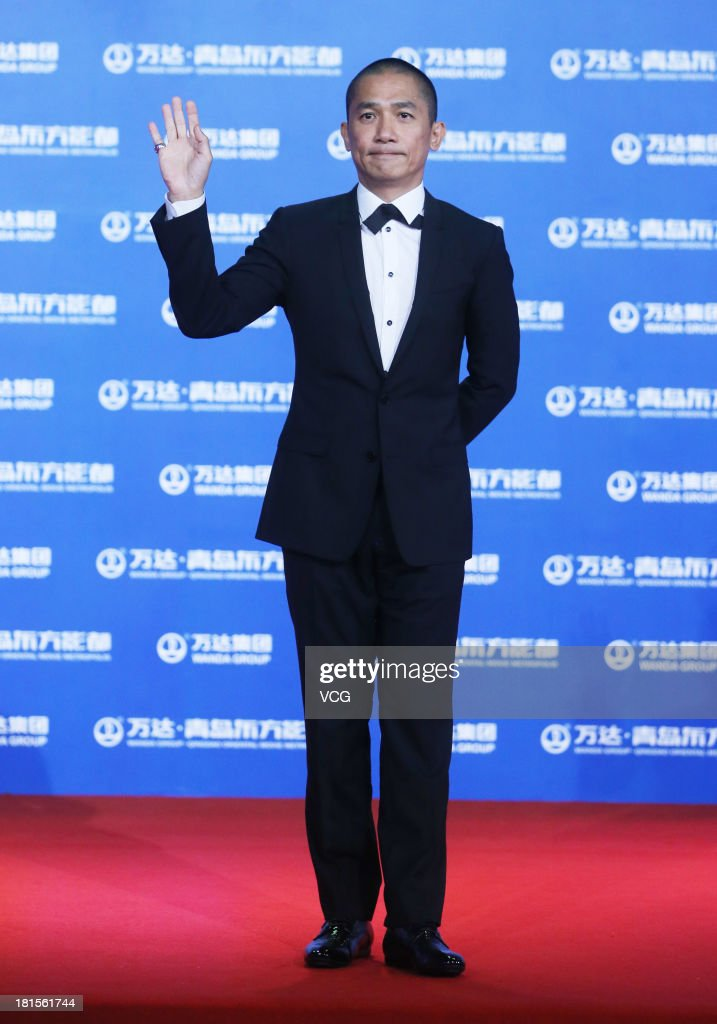 Actor Tony Leung Chiu-Wai arrives at the red carpet during the opening night of the Qingdao Oriental Movie Metropolis at Qingdao Beer City on September 22, 2013 in Qingdao, China.