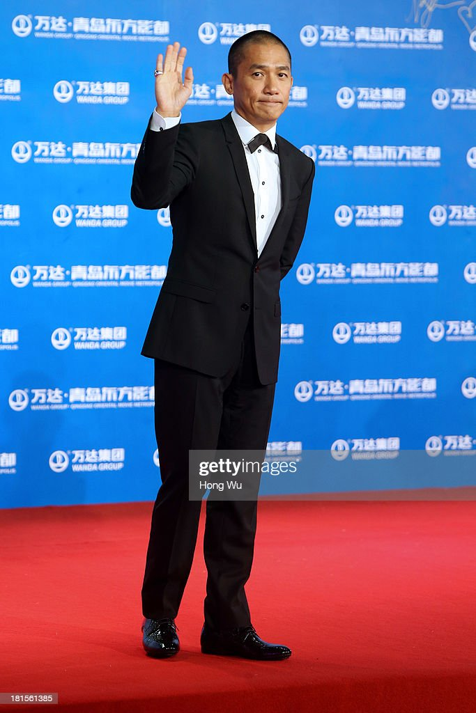 Actor Tony Leung Chiu-Wai attends the red carpet show for the Qingdao Oriental Movie Metropolis on September 22, 2013 in Qingdao, China.