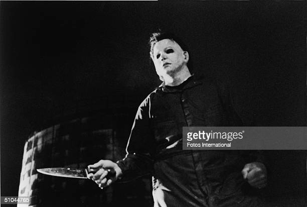 Actor Tony Moran as masked kiler Michael Myers wields a knife in a still from the horror film 'Halloween' directed by John Carpenter 1978