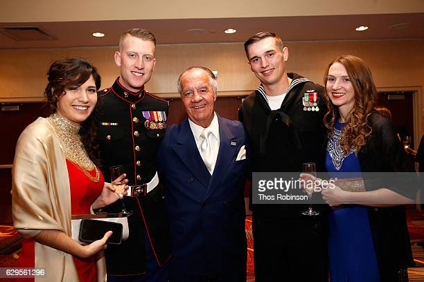Actor Tony Sirico poses with USO George Van Cleave Military Leadership Award winners US Marine Corps Cpl Daniel L Meinema and US Navy Petty Officer...