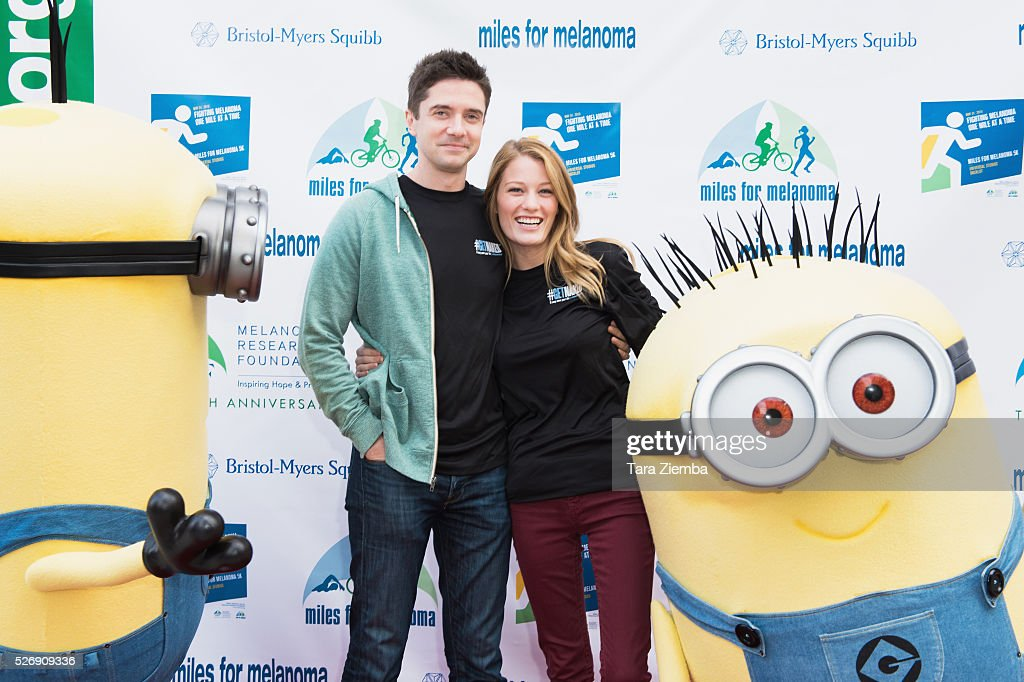 Actor <a gi-track='captionPersonalityLinkClicked' href=/galleries/search?phrase=Topher+Grace&family=editorial&specificpeople=203130 ng-click='$event.stopPropagation()'>Topher Grace</a> and Actress Ashley HInshaw attend the Melanoma Research Foundation's Miles for Melanoma 5k Run/Walk at Universal Studios Backlot on May 1, 2016 in Universal City, California.