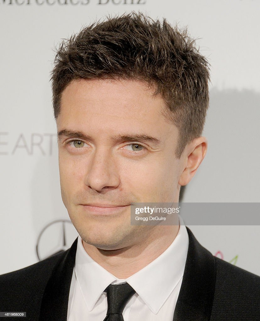 Actor Topher Grace arrives at The Art of Elysium's 7th Annual HEAVEN Gala at the Guerin Pavilion at the Skirball Cultural Center on January 11, 2014 in Los Angeles, California.
