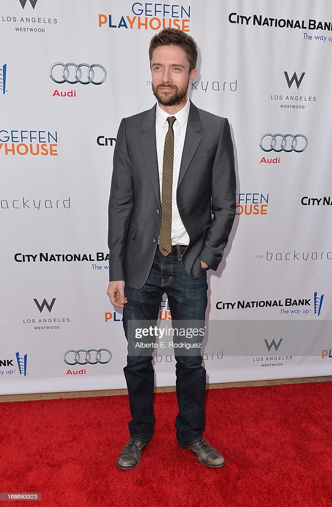 Actor <a gi-track='captionPersonalityLinkClicked' href=/galleries/search?phrase=Topher+Grace&family=editorial&specificpeople=203130 ng-click='$event.stopPropagation()'>Topher Grace</a> arrives to The Geffen Playhouse's Annual 'Backstage at the Geffen' Gala at Geffen Playhouse on May 13, 2013 in Los Angeles, California.