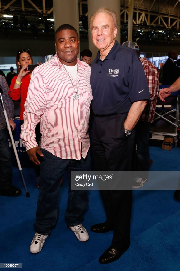 Actor Tracey Morgan and Former Dallas Cowboys quarterback <a gi-track='captionPersonalityLinkClicked' href=/galleries/search?phrase=Roger+Staubach&family=editorial&specificpeople=208812 ng-click='$event.stopPropagation()'>Roger Staubach</a> attend SiriusXM's Live Broadcast from Radio Row during Bowl XLVII week on February 1, 2013 in New Orleans, Louisiana.