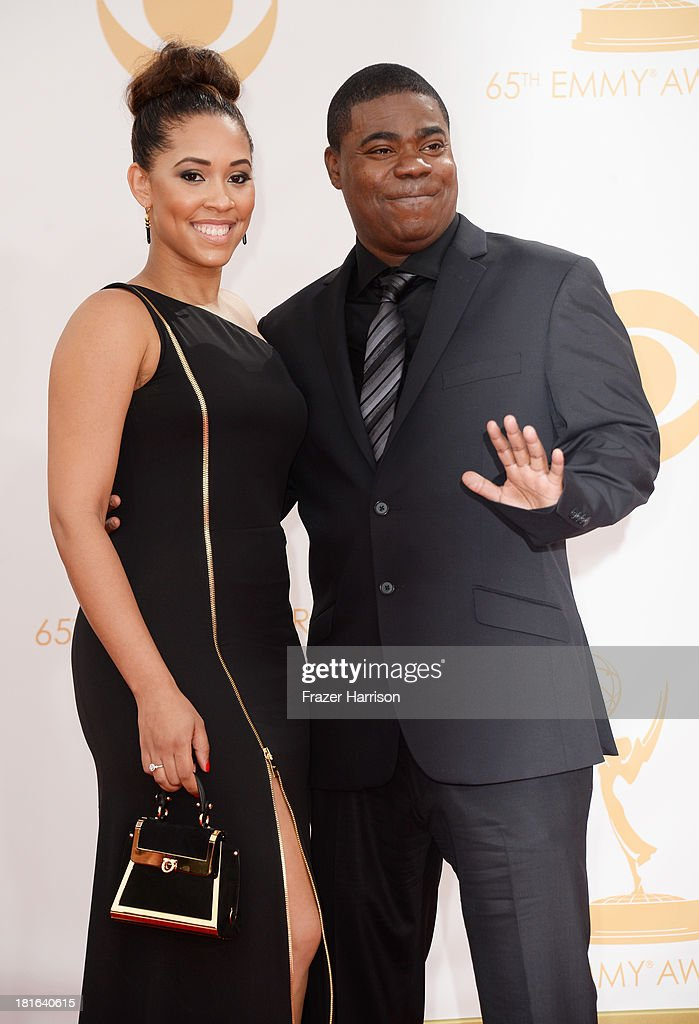 Actor Tracy Morgan (R) and Megan Wollover arrive at the 65th Annual Primetime Emmy Awards held at Nokia Theatre L.A. Live on September 22, 2013 in Los Angeles, California.