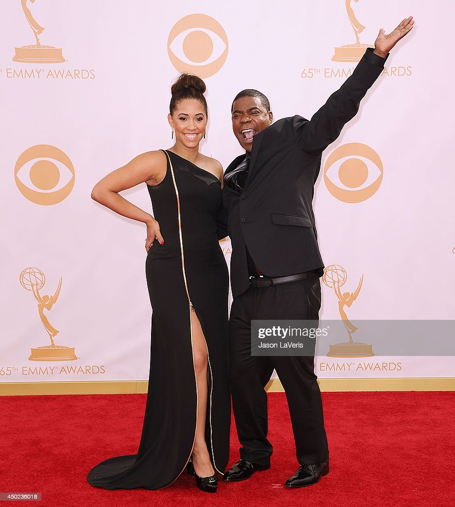 Actor <a gi-track='captionPersonalityLinkClicked' href=/galleries/search?phrase=Tracy+Morgan&family=editorial&specificpeople=182428 ng-click='$event.stopPropagation()'>Tracy Morgan</a> (R) and <a gi-track='captionPersonalityLinkClicked' href=/galleries/search?phrase=Megan+Wollover&family=editorial&specificpeople=8307276 ng-click='$event.stopPropagation()'>Megan Wollover</a> attend the 65th annual Primetime Emmy Awards at Nokia Theatre L.A. Live on September 22, 2013 in Los Angeles, California.