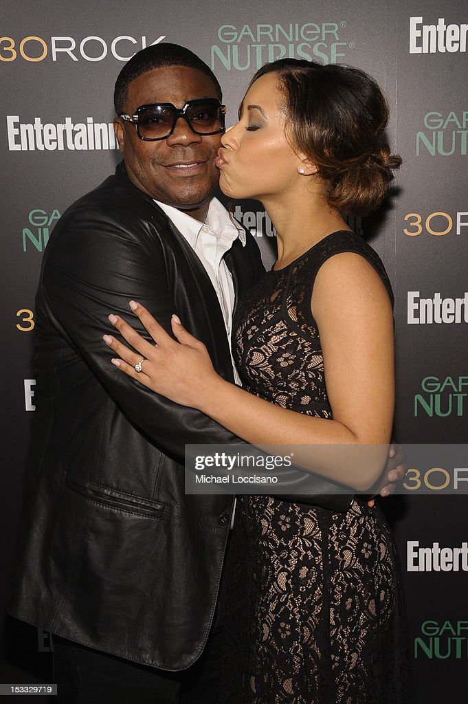 Actor <a gi-track='captionPersonalityLinkClicked' href=/galleries/search?phrase=Tracy+Morgan&family=editorial&specificpeople=182428 ng-click='$event.stopPropagation()'>Tracy Morgan</a> and Tanisha Hall attends Entertainment Weekly and NBC's celebration of the final season of 30 Rock sponsored by Garnier Nutrisse on October 3, 2012 in New York City.