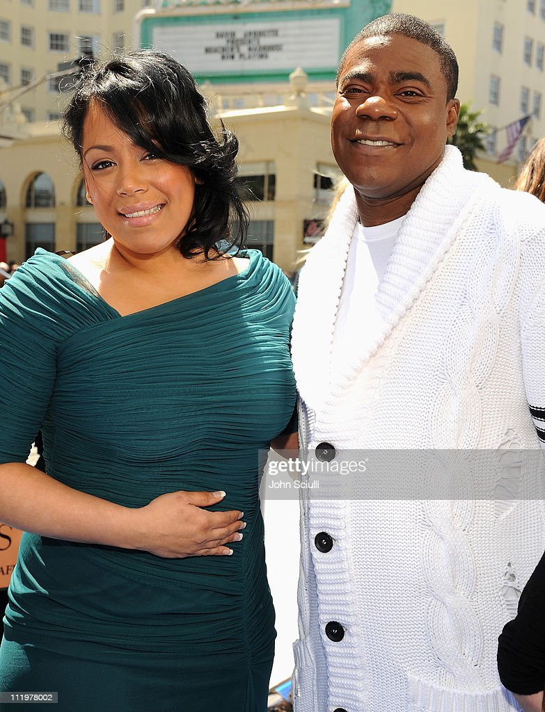 Actor <a gi-track='captionPersonalityLinkClicked' href=/galleries/search?phrase=Tracy+Morgan&family=editorial&specificpeople=182428 ng-click='$event.stopPropagation()'>Tracy Morgan</a> with his guest arrive for the premiere of Twentieth Century Fox & Blue Sky Studios' 'RIO' on April 10, 2011 in Hollywood, California.