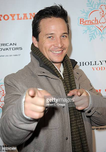 Actor Travis Aaron Wade arrives for the 2015 Babes In Toyland And BenchWarmer Charity Toy Drive held at Avalon on December 9 2015 in Hollywood...
