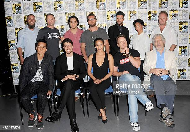 Actor Travis Fimmel producer Thomas Tull actor Ben Schnetzer director Duncan Jones actors Dominic Cooper Ruth Negga and Ben Foster actors Daniel Wu...