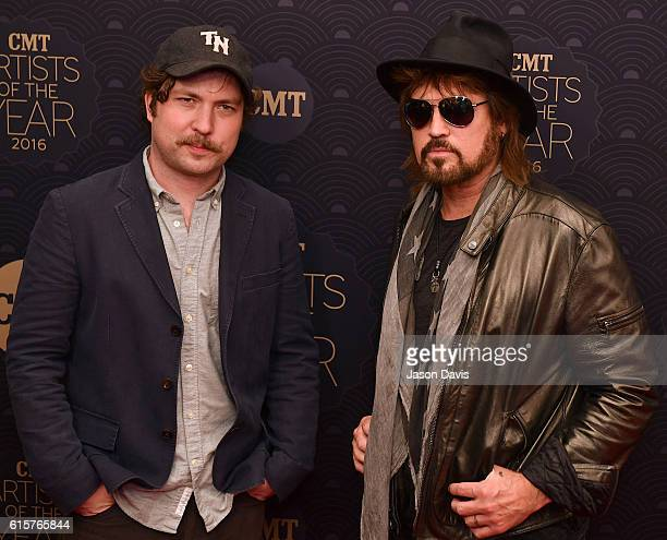 Actor Travis Nicholson and Recording Artist Billy Ray Cyrus arrive at 2016 CMT Artists of the Year at Schermerhorn Symphony Center on October 19 2016...