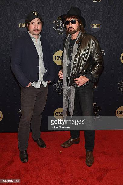 Actor Travis Nicholson and singersongwriter Billy Ray Cyrus arrive on the red carpet at CMT Artists of the Year 2016 on October 19 2016 in Nashville...