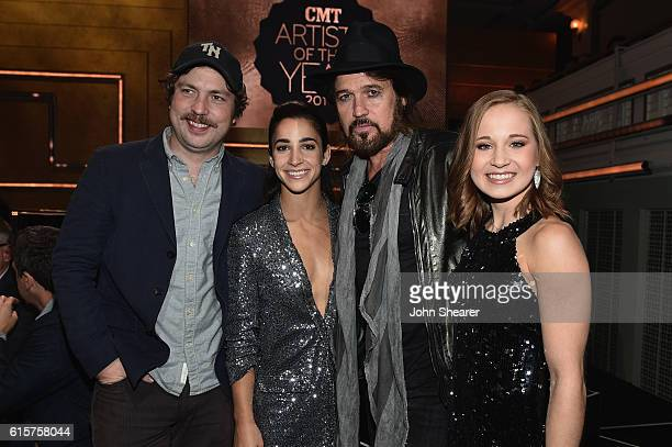 Actor Travis Nicholson gymnast Aly Raisman singersongwriter Billy Ray Cyrus and gymnast Madison Kocian take photos on stage at CMT Artists of the...
