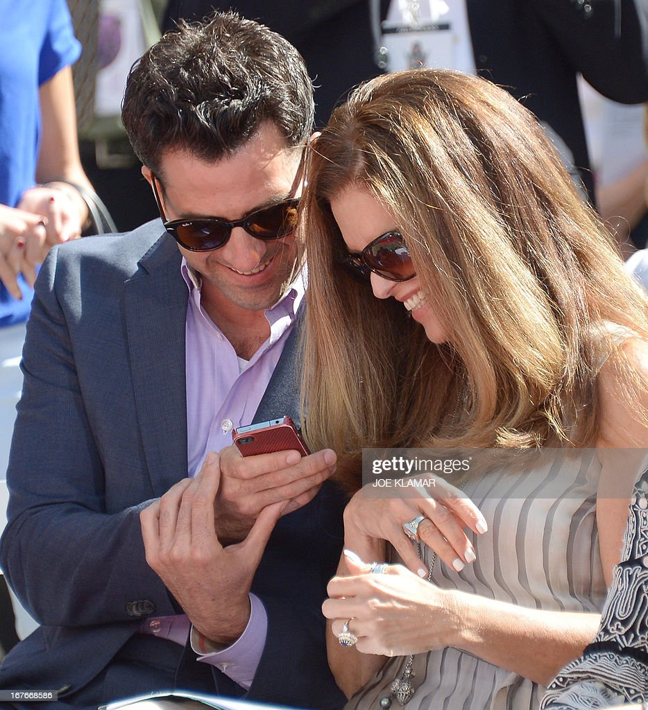 Actor Troy Garity and Maria Shriver attend Jane Fonda's Handprint/Footprint Ceremony during the 2013 TCM Classic Film Festival at TCL Chinese Theatre on April 27, 2013 in Los Angeles. Fonda is an American actress, writer, political activist, former fashion model, and fitness guru. She rose to fame in the 1960s with films such as Barbarella and Cat Ballou. She has won two Academy Awards, an Emmy Award, three Golden Globes and received several other movie awards and nominations during more than 50 years as an actress. After 15 years of retirement, she returned to film in 2005 with Monster-in-Law, followed by Georgia Rule two years later. She also produced and starred in over 20 exercise videos released between 1982 and 1995, and once again in 2010.