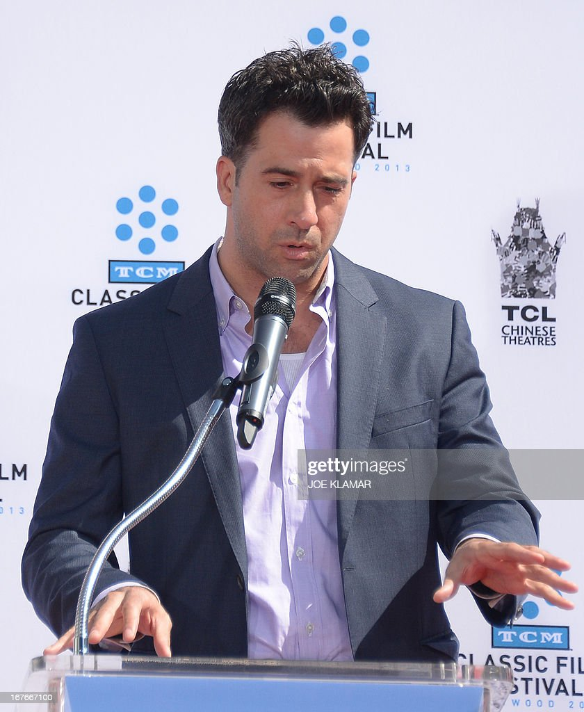 Actor Troy Garity, son of Jane Fonda, speaks during Jane Fonda's Handprint/Footprint Ceremony during the 2013 TCM Classic Film Festival at TCL Chinese Theatre on April 27, 2013 in Los Angeles. Fonda is an American actress, writer, political activist, former fashion model, and fitness guru. She rose to fame in the 1960s with films such as Barbarella and Cat Ballou. She has won two Academy Awards, an Emmy Award, three Golden Globes and received several other movie awards and nominations during more than 50 years as an actress. After 15 years of retirement, she returned to film in 2005 with Monster-in-Law, followed by Georgia Rule two years later. She also produced and starred in over 20 exercise videos released between 1982 and 1995, and once again in 2010.