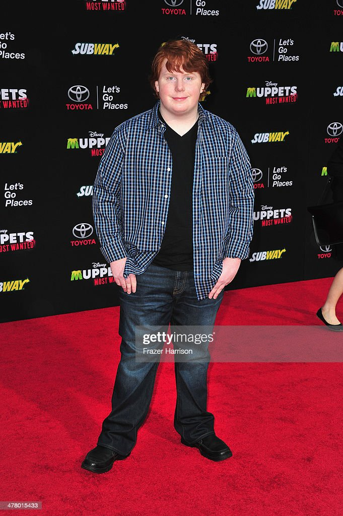 Actor Tucker Albrizzi arrives at the premiere Of Disney's 'Muppets Most Wanted' at the El Capitan Theatre on March 11 2014 in Hollywood California
