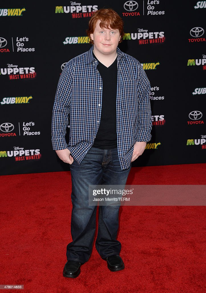 Actor Tucker Albrizzi attends the premiere of Disney's 'Muppets Most Wanted' at the El Capitan Theatre on March 11 2014 in Hollywood California