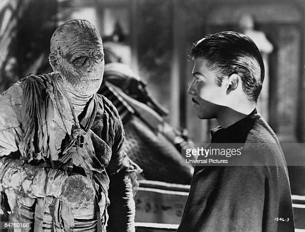 Actor Turhan Bey as Mehemet Bey faces Lon Chaney Jr as Kharis the Mummy in a scene from 'The Mummy's Tomb' 1942