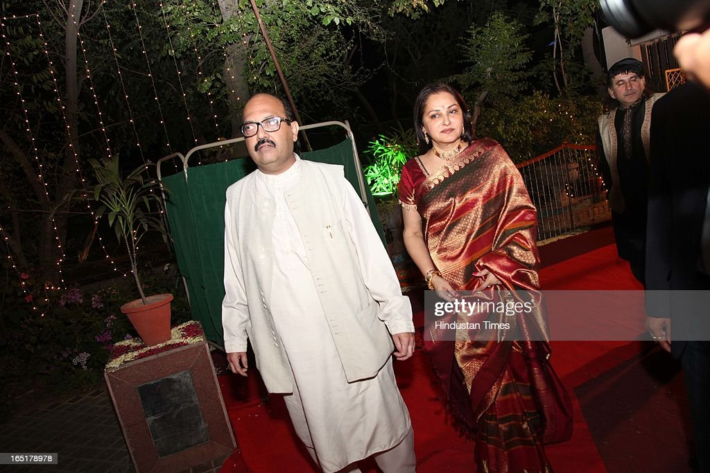 Actor turned politician Jaya Prada with politician Amar Singh at the wedding reception of educationist Dr SB Mujumdar's grandson Ameya Yeravdekar and Swati Thorat at Delhi Gymkhana on March 22, 2013 in New Delhi, India.