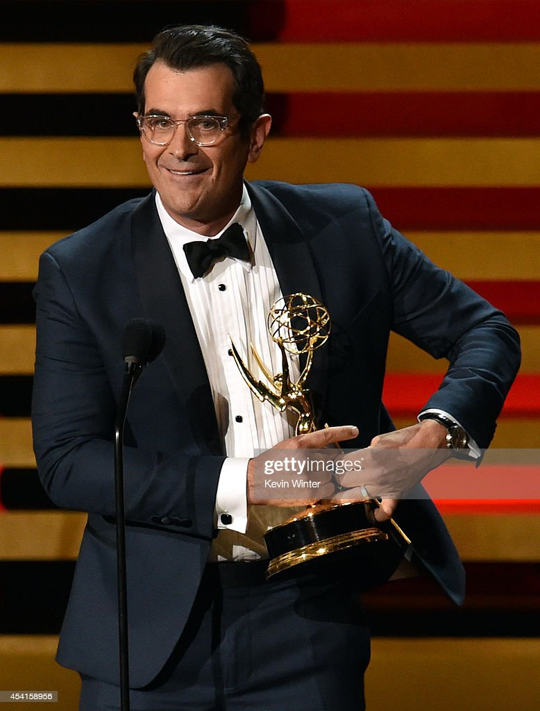 Actor Ty Burrell accepts Outstanding Supporting Actor in a Comedy Series for 'Modern Family' onstage at the 66th Annual Primetime Emmy Awards held at...