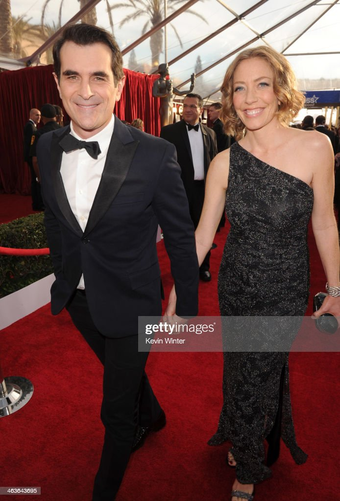 Actor <a gi-track='captionPersonalityLinkClicked' href=/galleries/search?phrase=Ty+Burrell&family=editorial&specificpeople=700077 ng-click='$event.stopPropagation()'>Ty Burrell</a> (L) and Holly Ann Brown attend 20th Annual Screen Actors Guild Awards at The Shrine Auditorium on January 18, 2014 in Los Angeles, California.