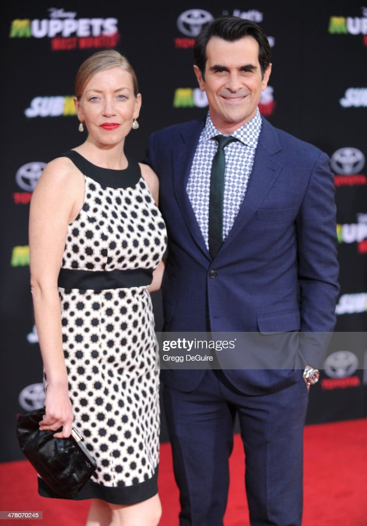 Actor <a gi-track='captionPersonalityLinkClicked' href=/galleries/search?phrase=Ty+Burrell&family=editorial&specificpeople=700077 ng-click='$event.stopPropagation()'>Ty Burrell</a> and Holly Burrell arrive at the Los Angeles premiere of 'Muppets Most Wanted' at the El Capitan Theatre on March 11, 2014 in Hollywood, California.