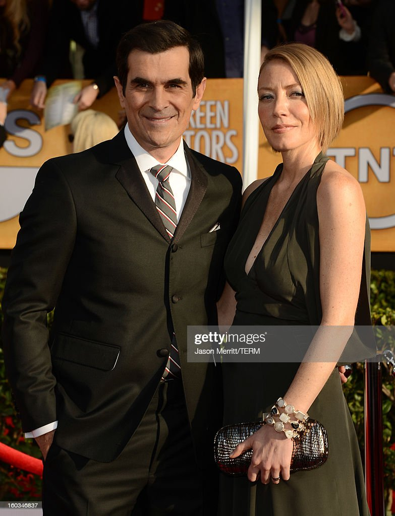 Actor <a gi-track='captionPersonalityLinkClicked' href=/galleries/search?phrase=Ty+Burrell&family=editorial&specificpeople=700077 ng-click='$event.stopPropagation()'>Ty Burrell</a> (L) and Holly Burrell attend the 19th Annual Screen Actors Guild Awards at The Shrine Auditorium on January 27, 2013 in Los Angeles, California. (Photo by Jason Merritt/WireImage) 23116_014_0534.JPG