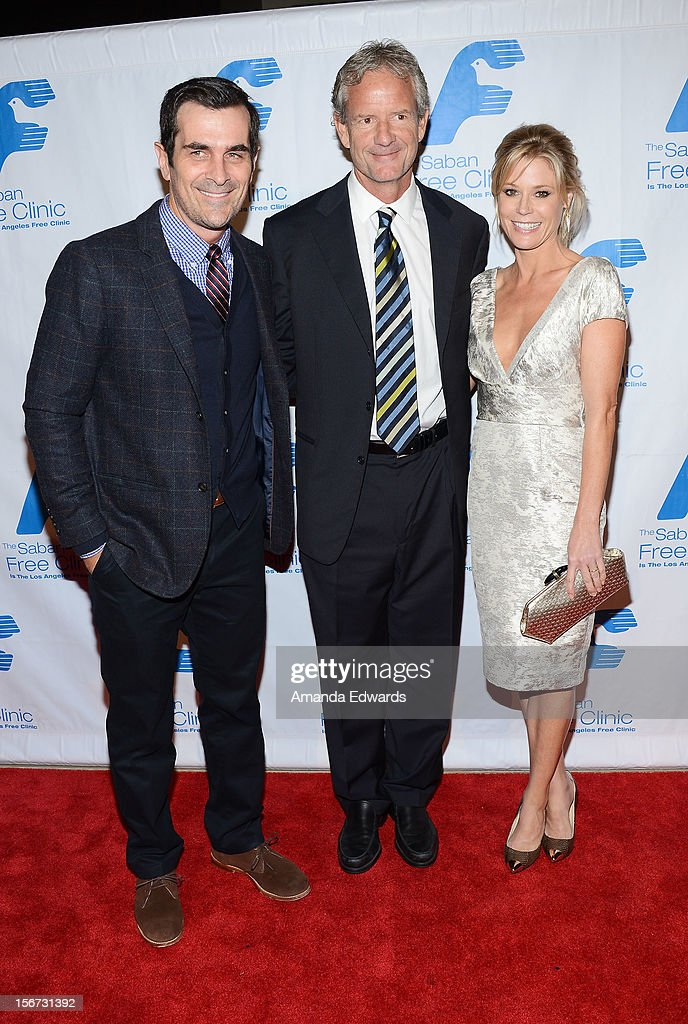 Actor Ty Burrell, Executive Producer Christopher Lloyd and actress Julie Bowen arrive at the Saban Free Clinic's 36th Annual Dinner Gala at The Beverly Hilton Hotel on November 19, 2012 in Beverly Hills, California.
