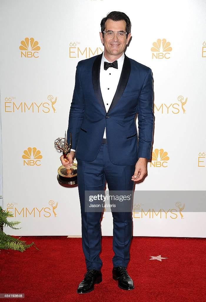 Actor Ty Burrell poses in the press room at the 66th annual Primetime Emmy Awards at Nokia Theatre LA Live on August 25 2014 in Los Angeles California