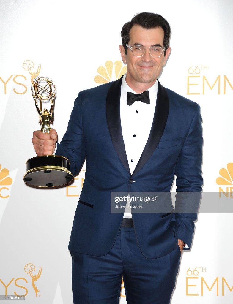 Actor <a gi-track='captionPersonalityLinkClicked' href=/galleries/search?phrase=Ty+Burrell&family=editorial&specificpeople=700077 ng-click='$event.stopPropagation()'>Ty Burrell</a> poses in the press room at the 66th annual Primetime Emmy Awards at Nokia Theatre L.A. Live on August 25, 2014 in Los Angeles, California.