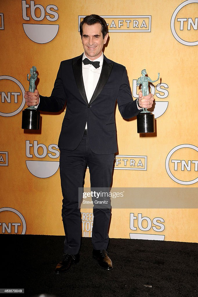 Actor Ty Burrell poses in the press room during the 20th Annual Screen Actors Guild Awards at The Shrine Auditorium on January 18 2014 in Los Angeles...