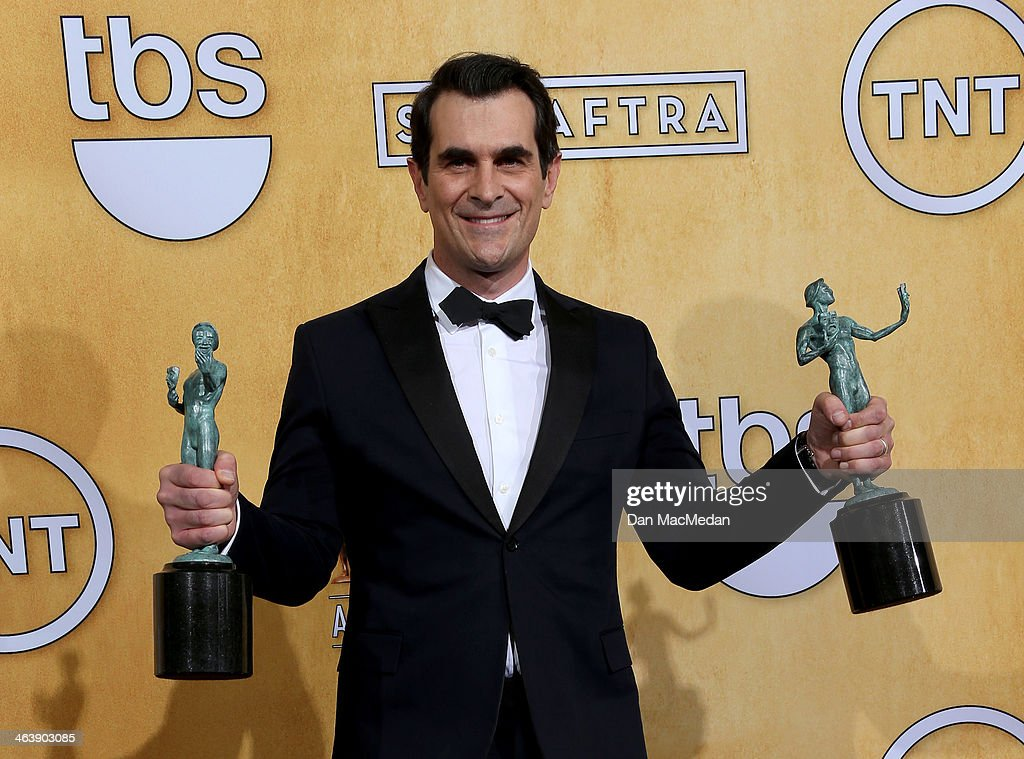 Actor <a gi-track='captionPersonalityLinkClicked' href=/galleries/search?phrase=Ty+Burrell&family=editorial&specificpeople=700077 ng-click='$event.stopPropagation()'>Ty Burrell</a> poses in the press room with the award for Outstanding Performance by an Ensemble in a Comedy Series for 'Modern Family' at the 20th Annual Screen Actors Guild Awards at the Shrine Auditorium on January 18, 2014 in Los Angeles, California.