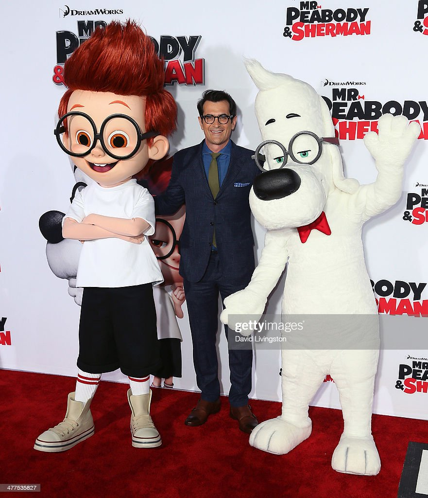 Actor Ty Burrell poses with Sherman and Mr Peabody at the premiere of Twentieth Century Fox and DreamWorks Animation's 'Mr Peabody Sherman' at the...