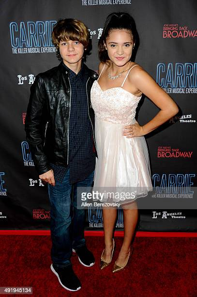 Actor Ty Simpkins and actress Luna Blaise attend the 'Carrie The Killer Musical Experience' opening night red carpet at Los Angeles Theatre on...