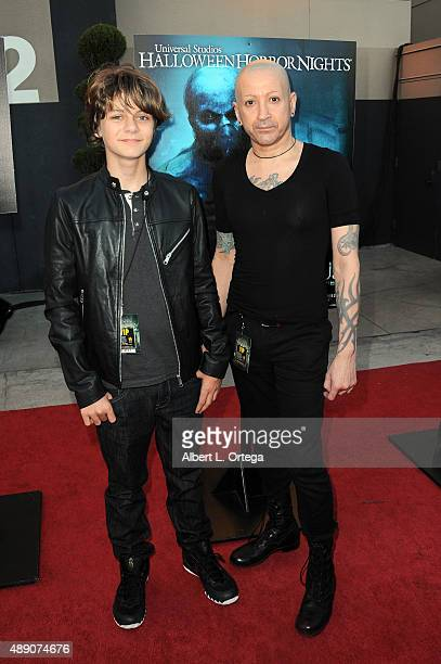 Actor Ty Simpkins and composer Joseph Bishara arrive for Universal Studios Hollywood's Opening Night Celebration Of 'Halloween Horror Nights' held at...