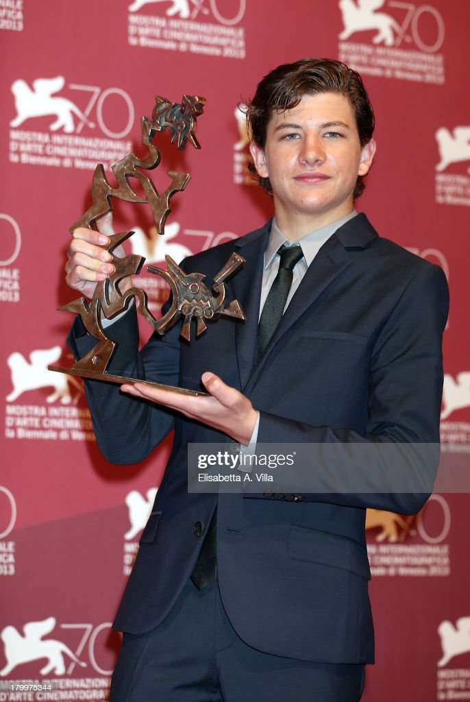 Actor <a gi-track='captionPersonalityLinkClicked' href=/galleries/search?phrase=Tye+Sheridan&family=editorial&specificpeople=7807719 ng-click='$event.stopPropagation()'>Tye Sheridan</a> poses with the Marcello Mastroianni Award for the Best Young Actor he received for the movie 'Joe' as he attends the Award Winners Photocall during the 70th Venice International Film Festival at Palazzo del Casino on September 7, 2013 in Venice, Italy.