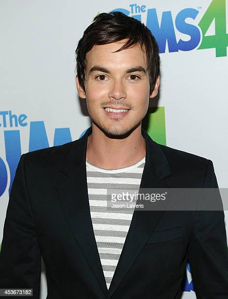 Actor Tyler Blackburn poses in the green room at the 2014 Teen Choice Awards at The Shrine Auditorium on August 10 2014 in Los Angeles California