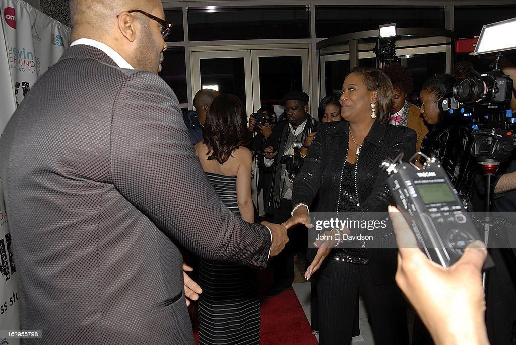 Actor Tyler Perry greets Karyn Greer, 11Alives newswoman at the 'Kunta Kinteh Island: Coming Home Without Shackles' premiere at the Woodruff Arts Center on March 1, 2013 in Atlanta, Georgia.