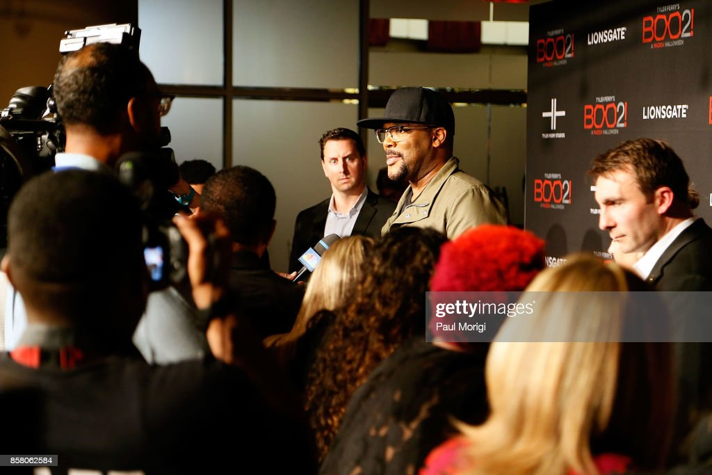 Actor Tyler Perry talks with the press at Tyler Perry's 'Boo2! A Madea Halloween' premiere at AMC Mazza Gallerie 14 on October 5, 2017 in Washington, DC.