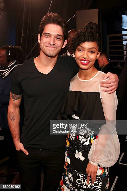 Actor Tyler Posey and actress Yara Shahidi pose backstage at the People's Choice Awards 2017 at Microsoft Theater on January 18 2017 in Los Angeles...