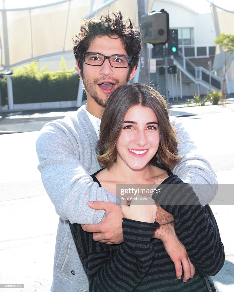 Actor Tyler Posey (L) and his Girlfriend Seana Gorlick (R) attend PATH's 4th Annual Thanksgiving Meal at Pink Taco on November 22, 2012 in Los Angeles, California.