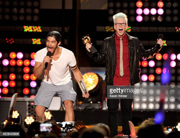 Actor Tyler Posey and Tyler Oakley speak onstage at the MTVu Fandom Awards during ComicCon International 2014 at PETCO Park on July 24 2014 in San...
