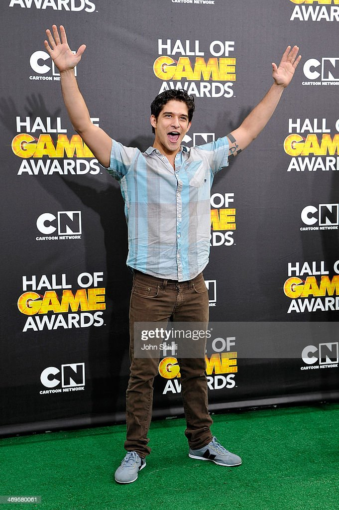 Actor <a gi-track='captionPersonalityLinkClicked' href=/galleries/search?phrase=Tyler+Posey&family=editorial&specificpeople=3201481 ng-click='$event.stopPropagation()'>Tyler Posey</a> attends Cartoon Network's fourth annual Hall of Game Awards at Barker Hangar on February 15, 2014 in Santa Monica, California.