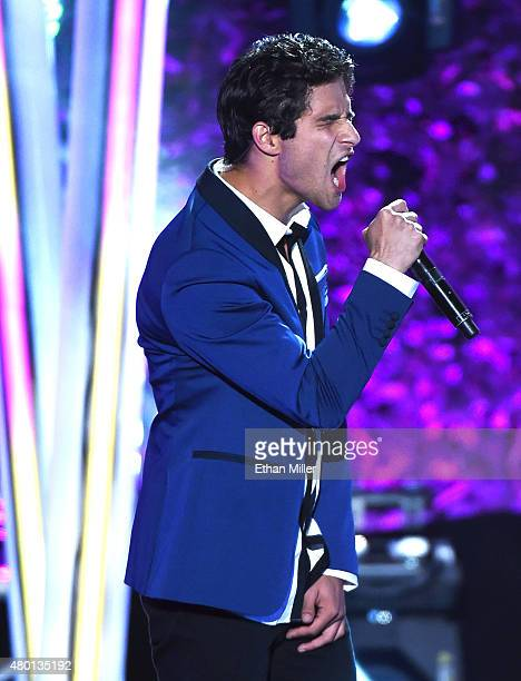 Actor Tyler Posey performs onstage during the MTV Fandom Fest San Diego ComicCon at PETCO Park on July 9 2015 in San Diego California