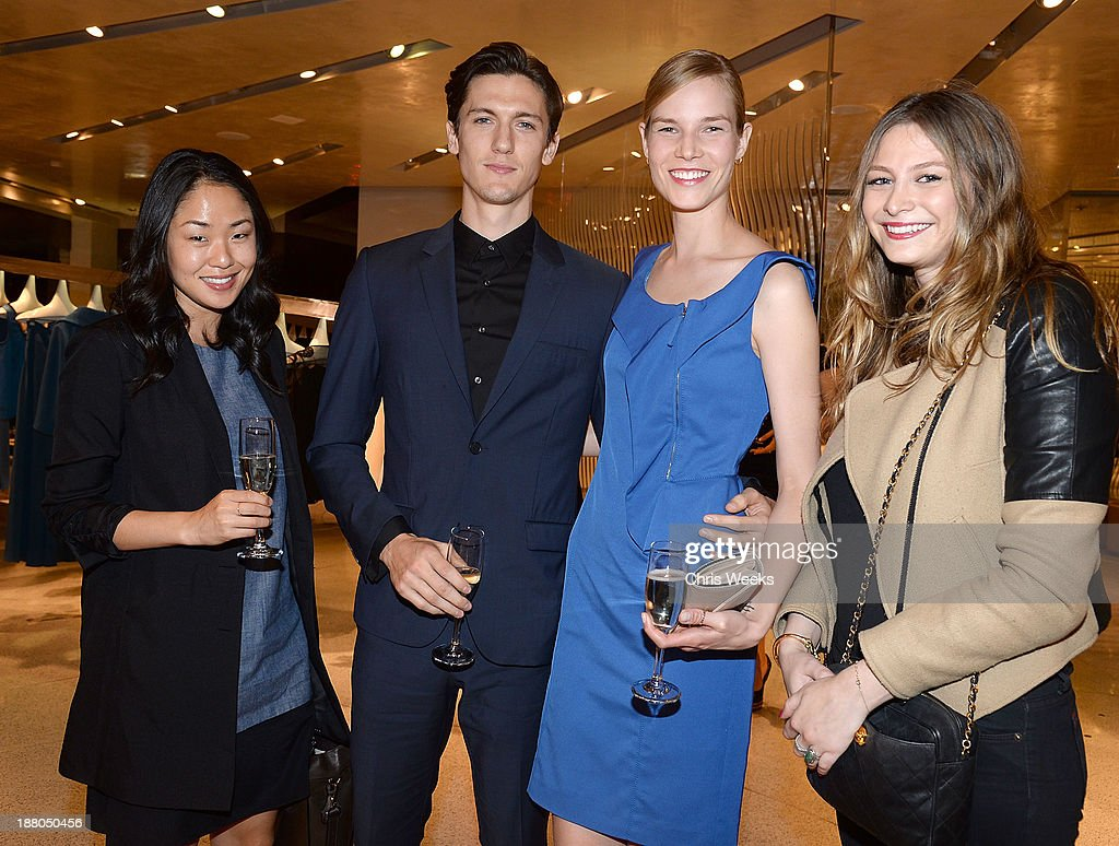 Actor Tyler Riggs, model Suvi Riggs and guests attend Leslie Zemeckis' book signing for 'Behind the Burly Q' at Alberta Ferretti Boutique on November 14, 2013 in West Hollywood, California.